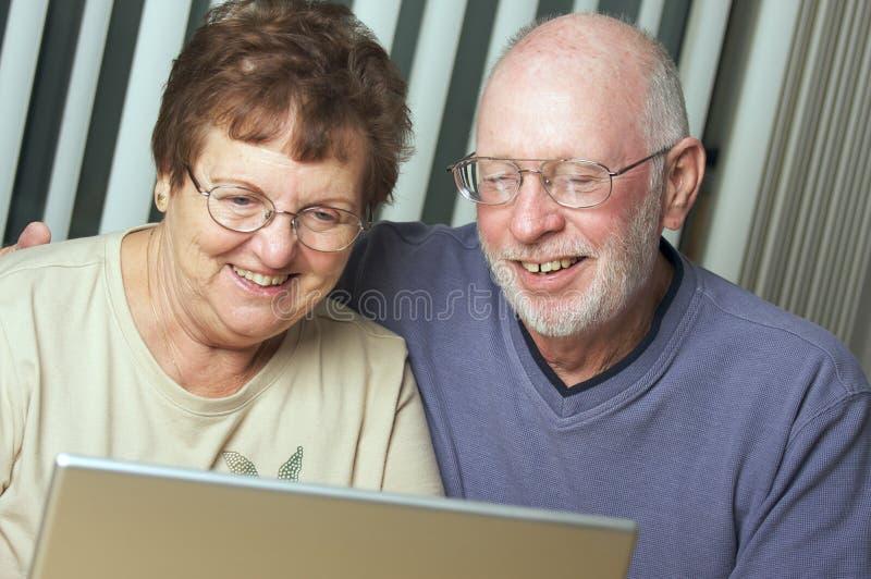 Senior Adults on Laptop Computer stock photo