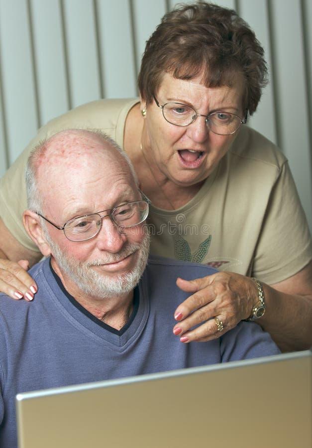 Senior Adults on Laptop Computer stock photos