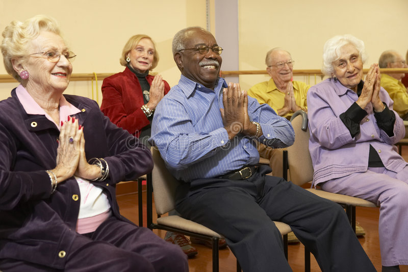 Senior adults in a stretching class royalty free stock images