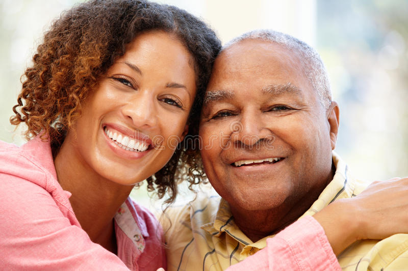 Senior African American man and granddaughter stock images