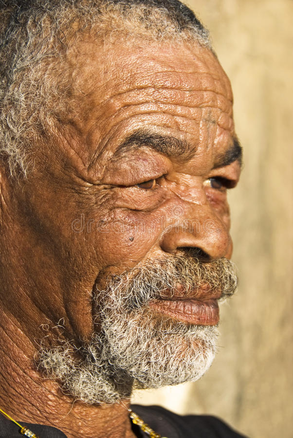 Senior African man. Relaxing in the African sun royalty free stock photo