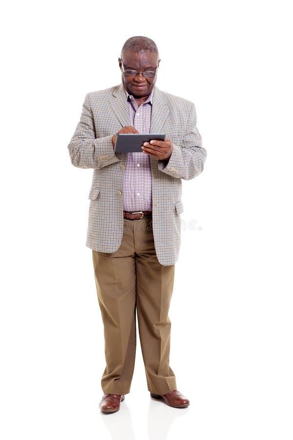 Download Senior african man tablet stock image. Image of modern - 33291173