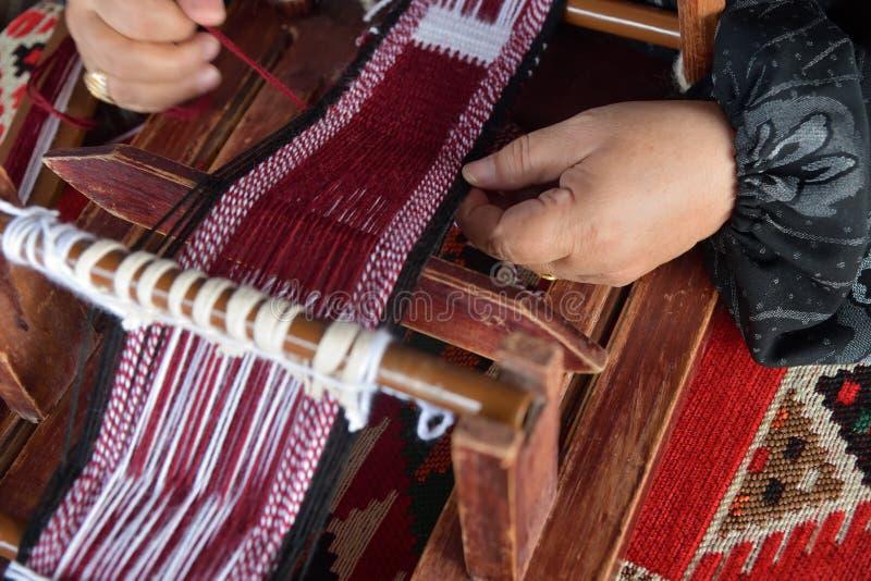 Hands of an arabian female weaver stock images