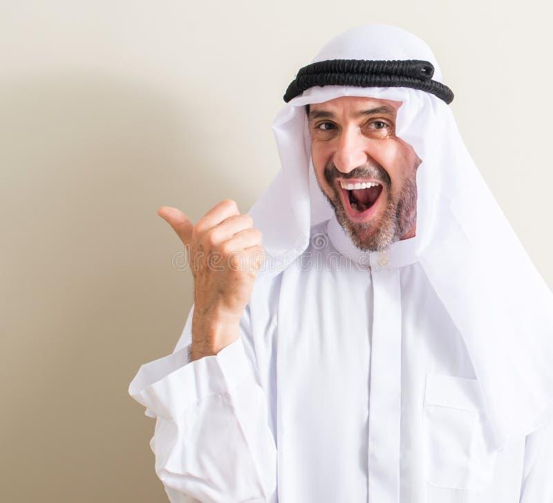 Handsome senior arabian man at home stock images