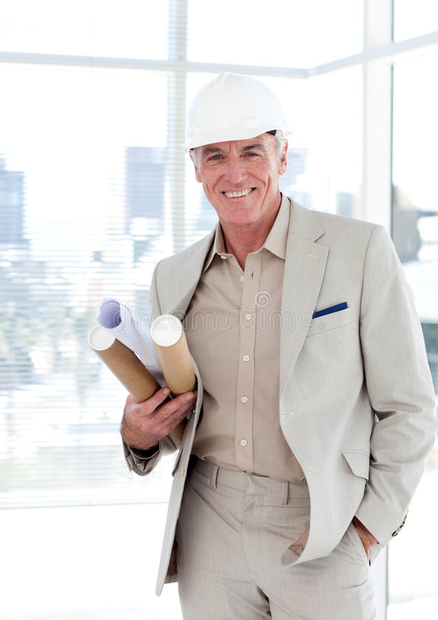 Download Senior Architect With A Hardhat Holding Blueprints Stock Photo - Image: 12118856