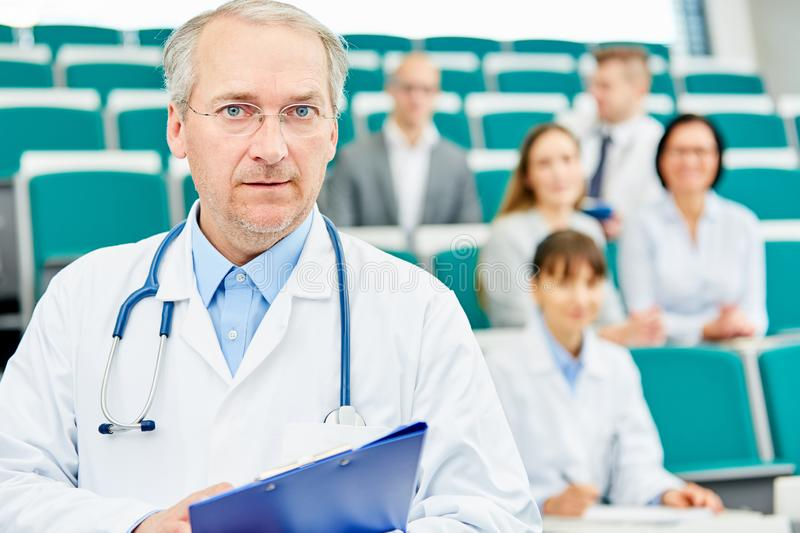 Senior as competent doctor and professor stock images