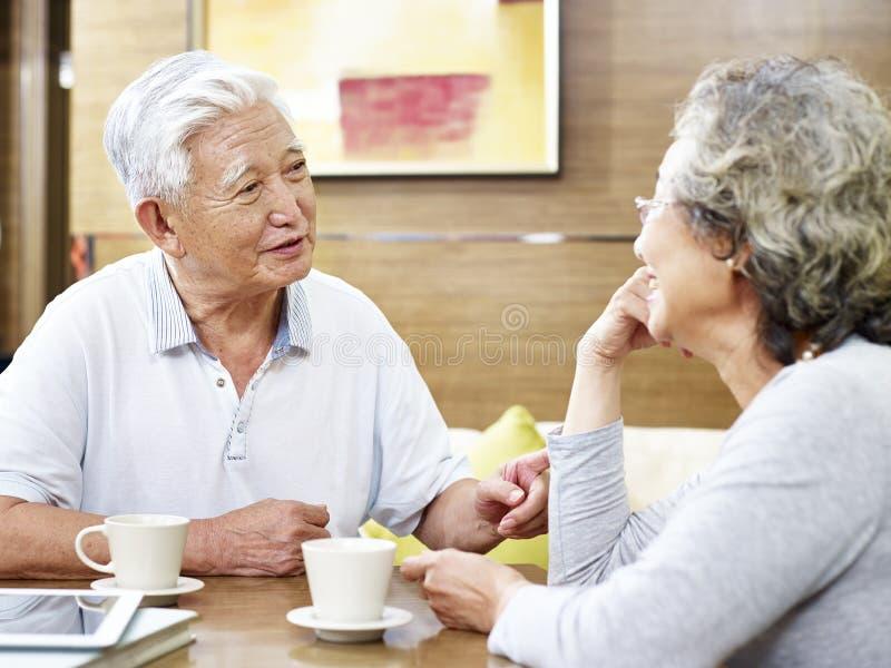 Senior asian couple chatting at home stock photos