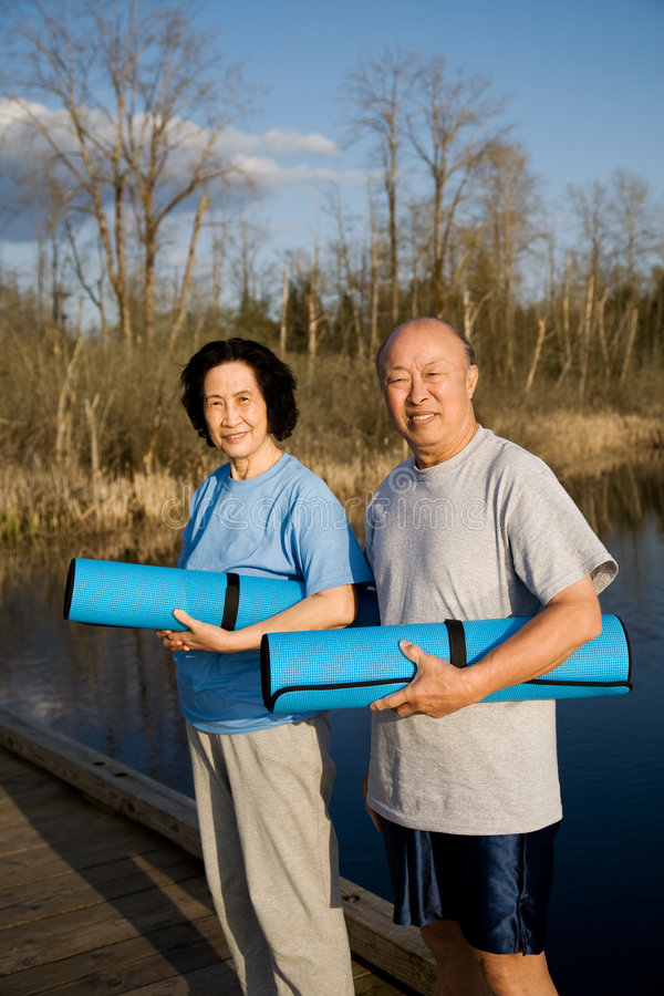 Senior asian couple exercise stock images