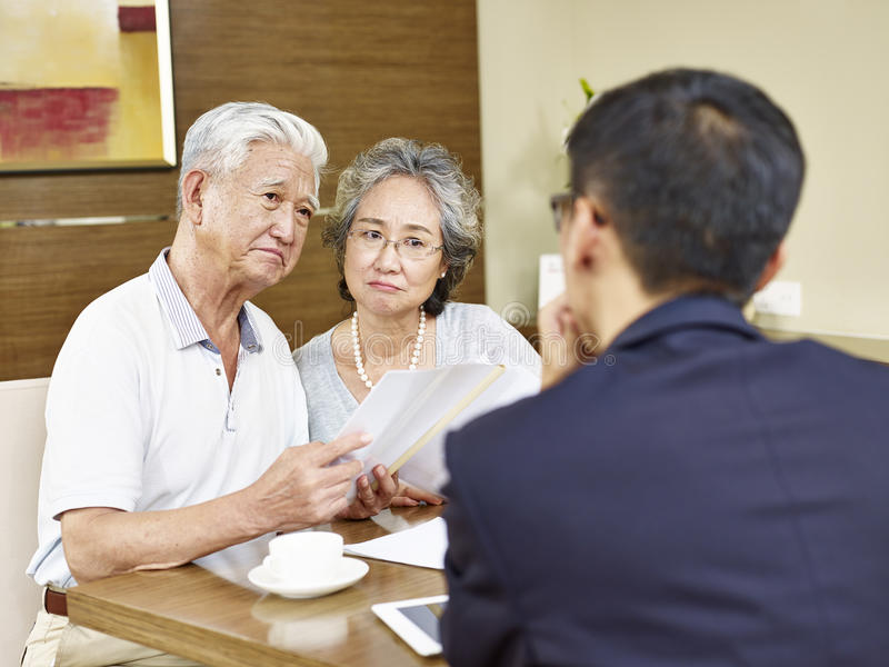 Senior asian couple meeting a sales rep stock images