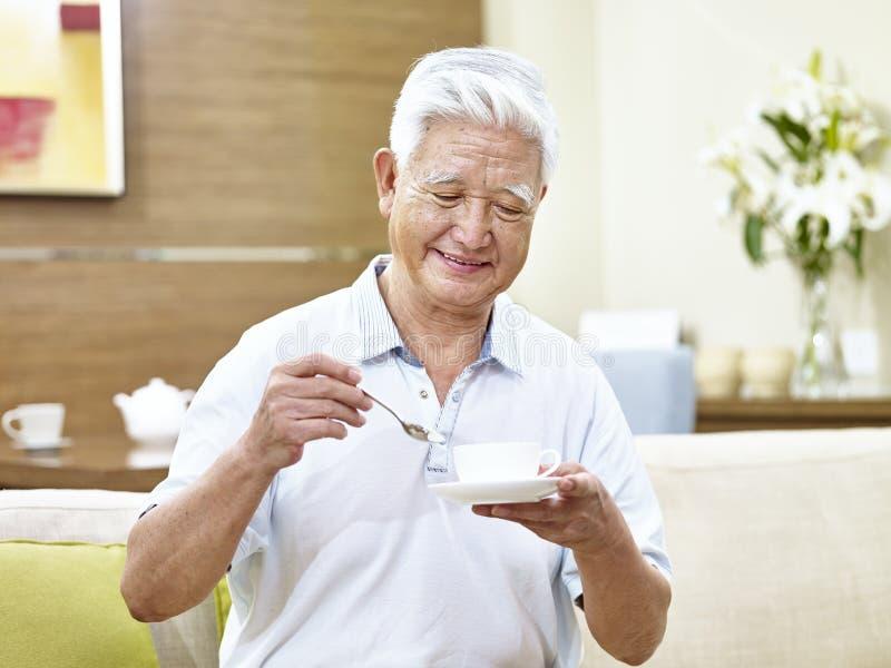 Senior asian man drinking coffee stock images