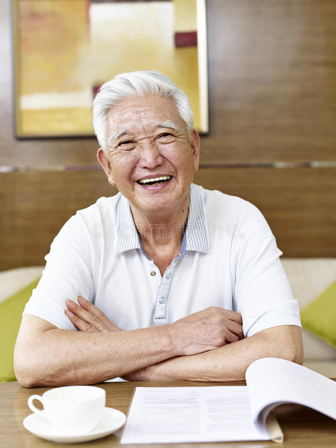 Senior asian man reading in study room royalty free stock images