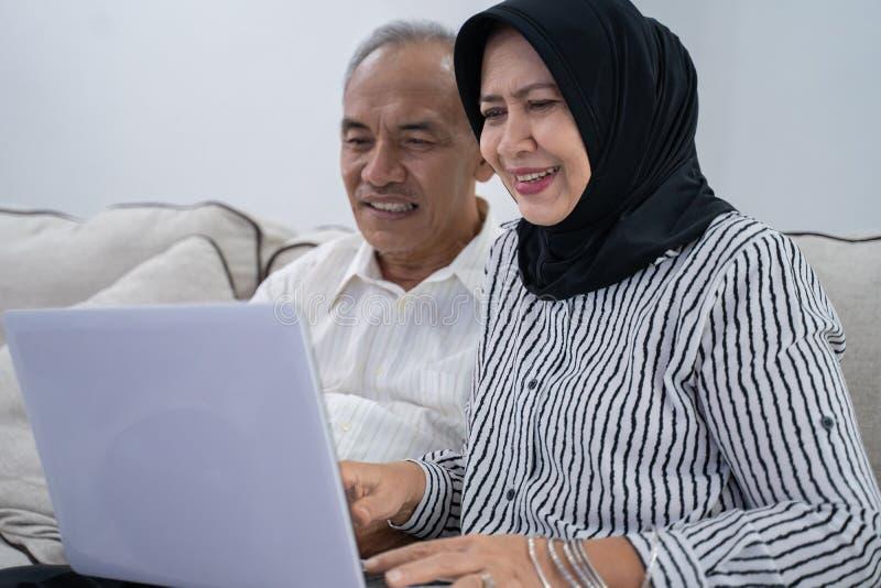 Senior asian muslim couple using laptop royalty free stock images
