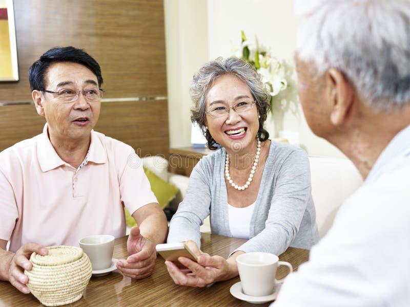 Senior asian people chatting royalty free stock photo