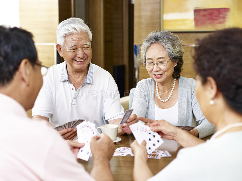 Senior asian people playing cards royalty free stock photos