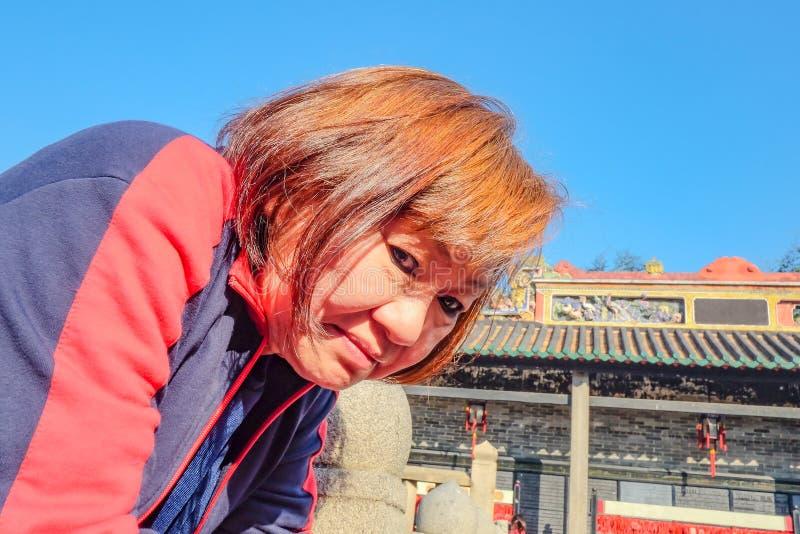 Senior asian tourist women in The Ancestral temple. Senior asian tourist woman in The Ancestral temple.Foshan city china stock photo