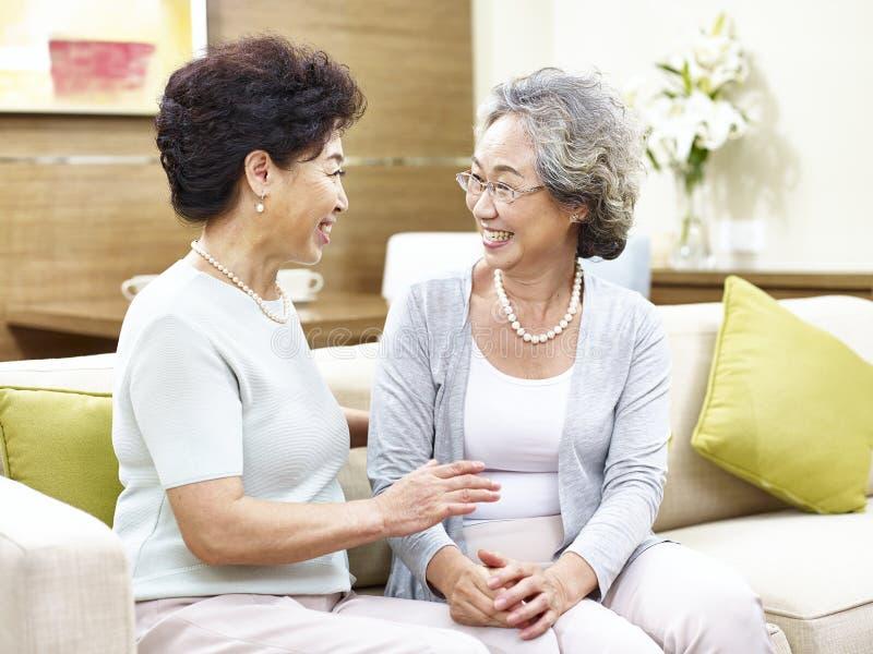 Senior asian woman chatting at home royalty free stock images