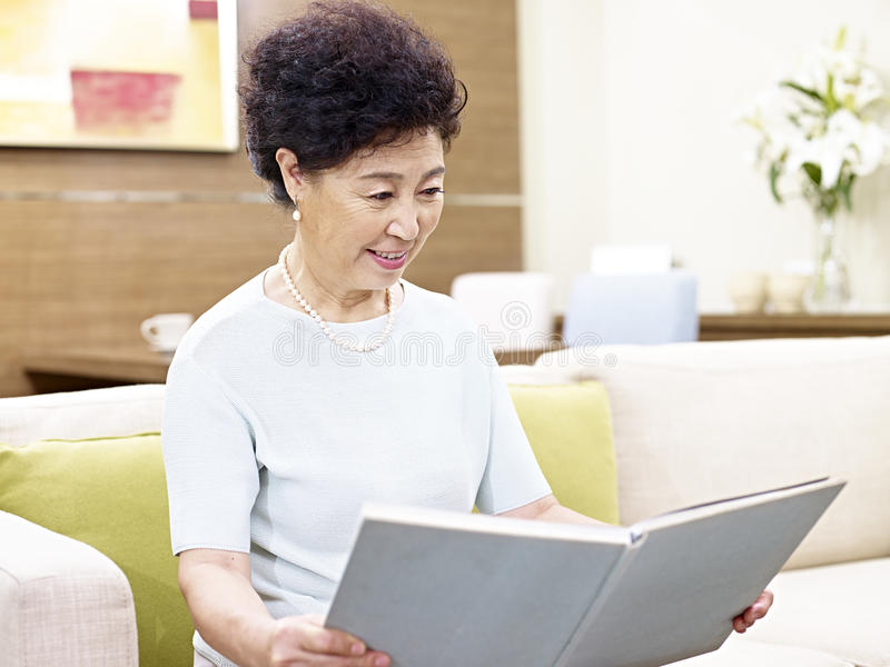 Senior asian woman reading a book royalty free stock image