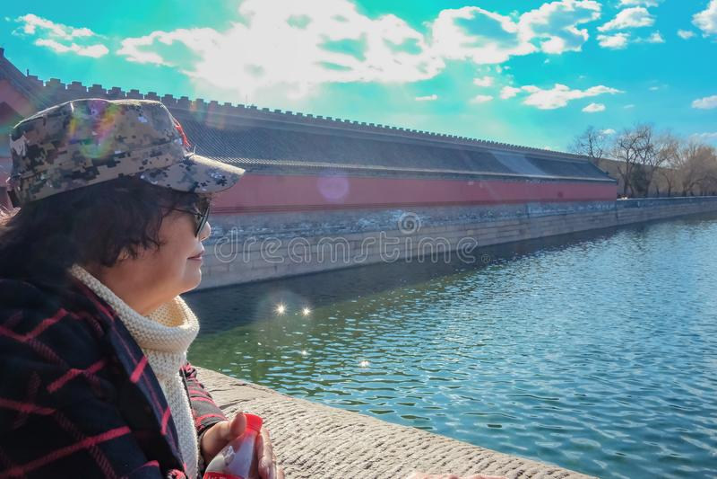 Senior asian women traveler with beautiful tongzi river at Beijing stock image