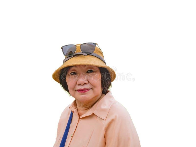 Senior Asian women Traveler wear a Hat. Senior Asian woman Traveler wear a Hat on isolated background stock images