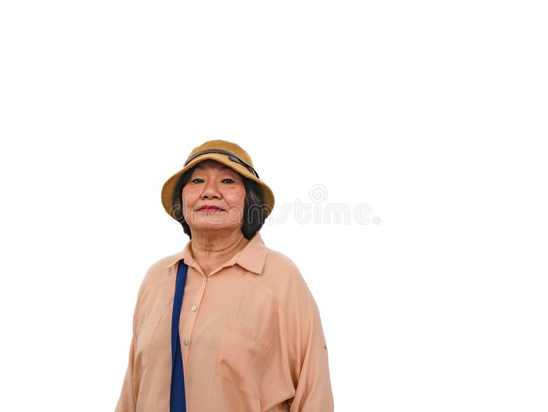 Senior Asian women Traveler wear a Hat. Senior Asian woman Traveler wear a Hat on isolated background stock photo