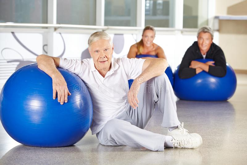 Senior in back training with gym ball royalty free stock images