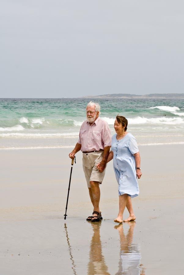 Senior Beach Walk royalty free stock photography