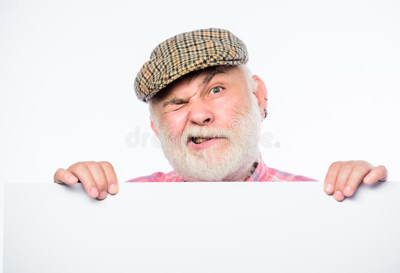 Senior bearded emotional man peek out of banner place announcement. Elderly person. Announcement concept. Event royalty free stock photos