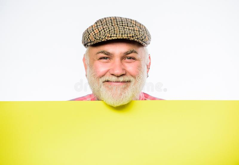 Senior bearded man place announcement on banner. Advertisement shop. happy mature man in retro hat. Advertisement. job royalty free stock photo