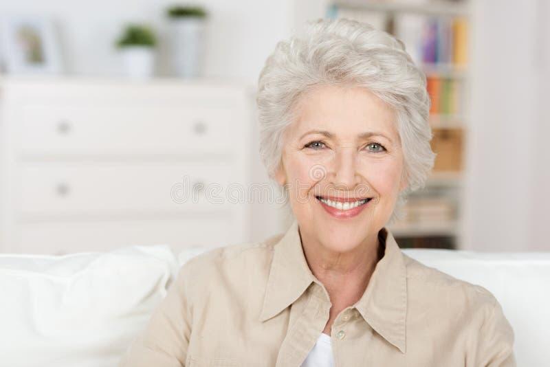 Senior beautiful woman enjoying the retirement royalty free stock image
