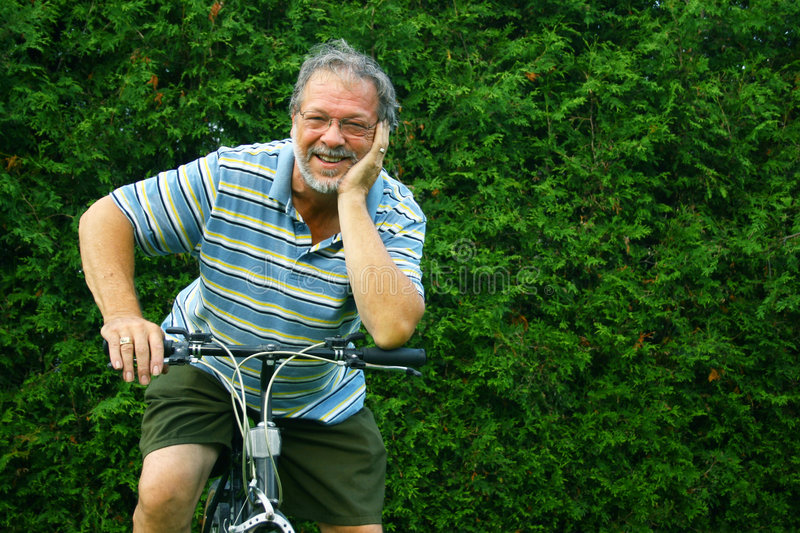 Senior and bicycle. Happy senior man with a bicycle