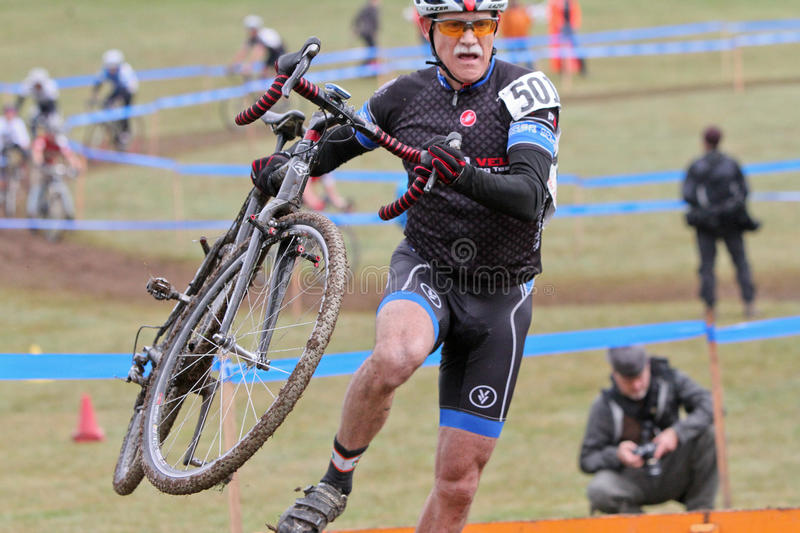 Senior Bicycle Racer Competes At Cycloross Event Editorial Stock Image