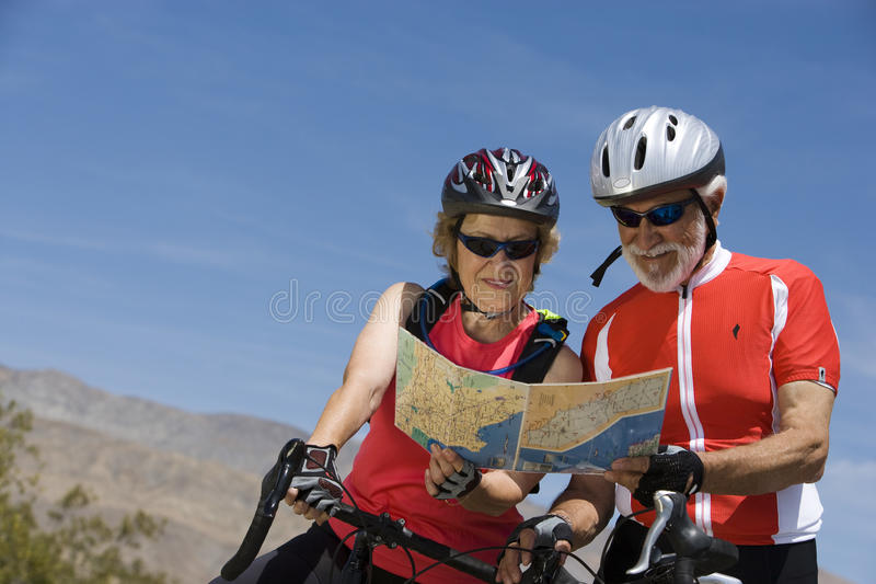 Download Senior Bicyclists Reading Map Together Stock Photo - Image: 29649720