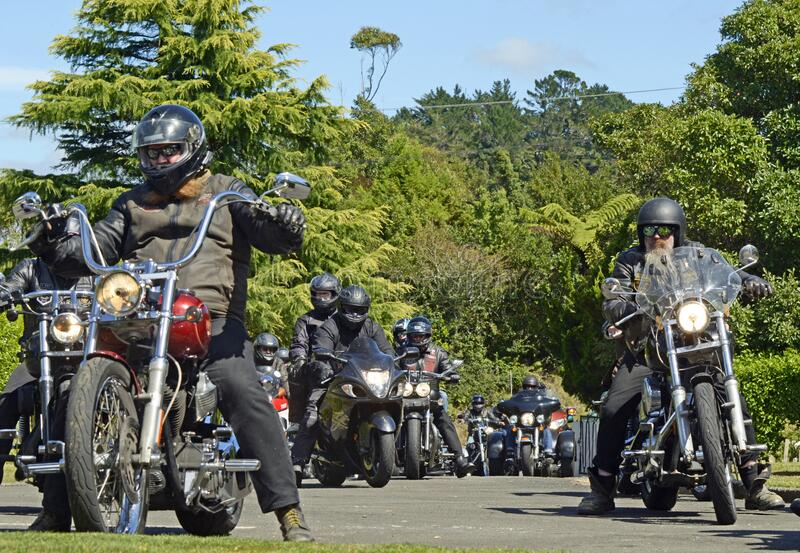 Senior bikers lead bike ride run in memory of fallen brother. Senior bikers lead the way for a bike ride run from Stratford to New Plymouth in New Zealand in stock photos