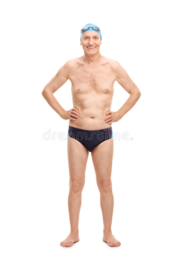 Senior in black swim trunks and blue swimming cap. Full length portrait of a shirtless senior in black swim trunks and blue swimming cap looking at the camera royalty free stock photos