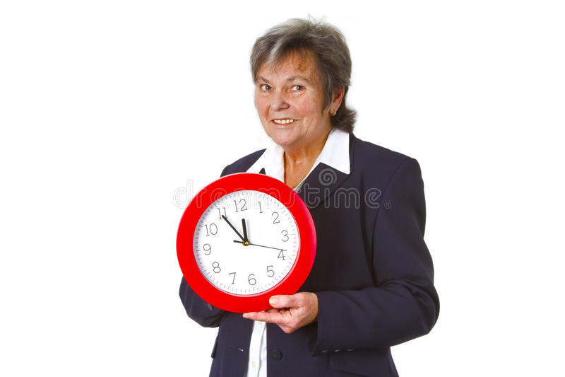 Senior boss holding a round clock stock image