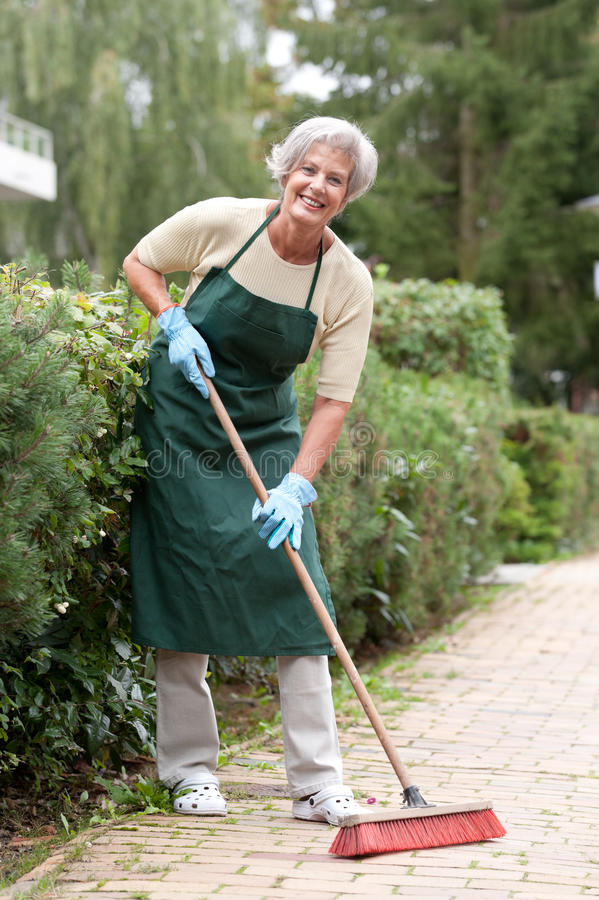 Senior With Broom Stock Images