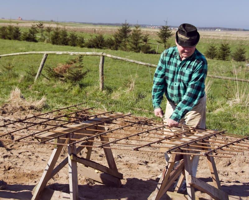 Download Senior builder at work stock photo. Image of frame, labour - 5024178