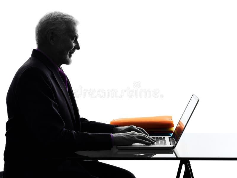 Senior business man computing smiling silhouette. One Caucasian Senior Business Man computing laptop smiling Silhouette White Background stock photos