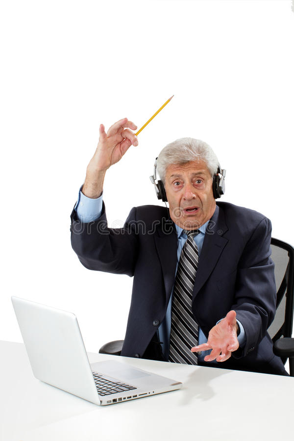 Senior business man getting ideas. Senior business man sitting at desk wears headphones, waves pencil, gets ideas. Isolated on white, vertical, copy space stock images