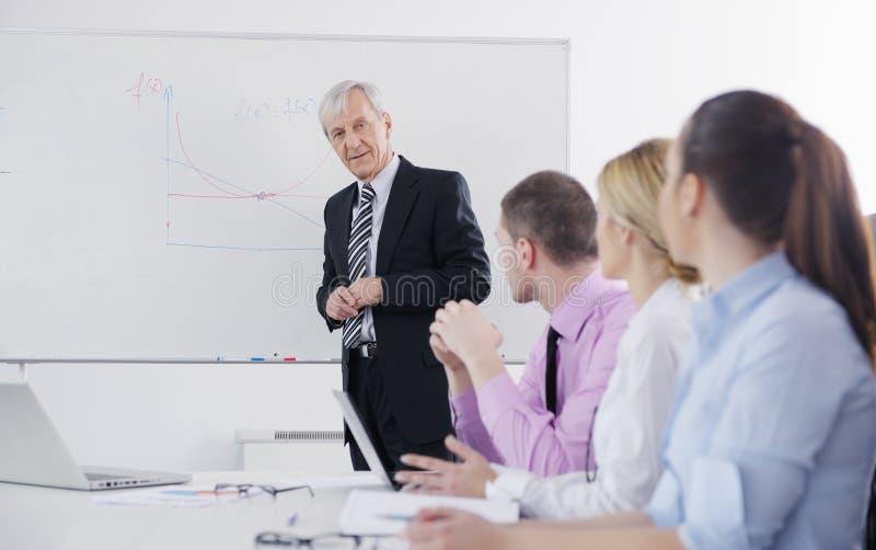 Download Senior Business Man Giving A Presentation Royalty Free Stock Photos - Image: 23624598
