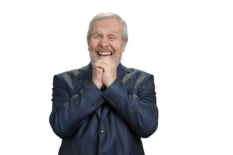 Senior business man laughing hard with folded hands. stock photo