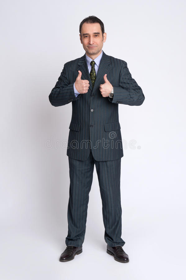Senior business man showing thumbs up gesture stock photos