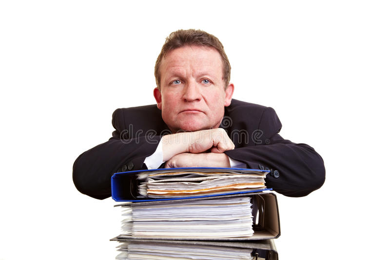 Senior business man with stack royalty free stock image