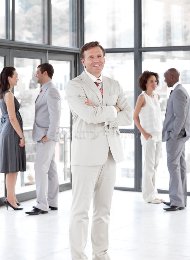 Senior Business man standing Business team. Senior attractive Business man standing in front of Business team stock images