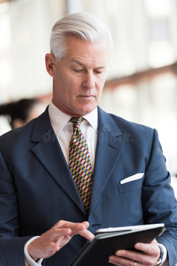 Download Senior Business Man Working On Tablet Computer Stock Image - Image of mature, health: 71647097