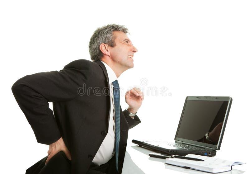 Senior business men having back pain royalty free stock photo