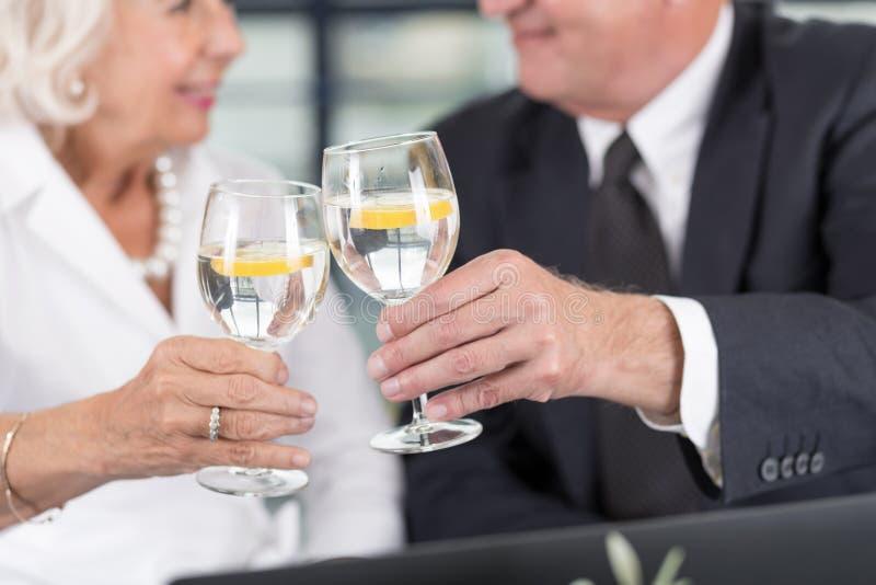 Senior business pair celebrating royalty free stock photo