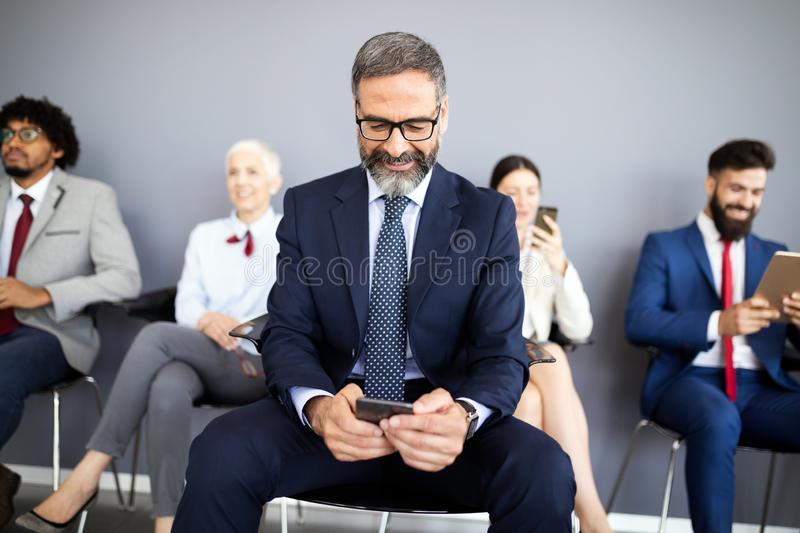 Senior business people using mobile phone. Telecommunication technology and internet of things. Senior business people using mobile phone. Future stock photos