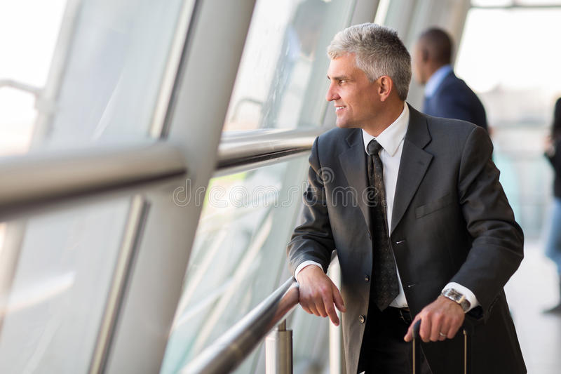 Senior business traveler royalty free stock photography