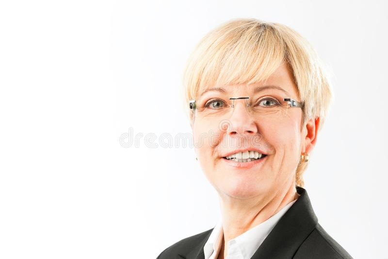 Senior business woman smiling wearing eyeglasses royalty free stock image